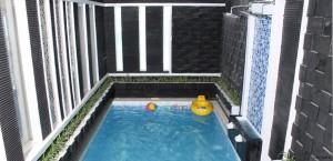 villa kolam renang batu